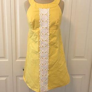 Short, yellow, cute Lilly Pulitzer dress.